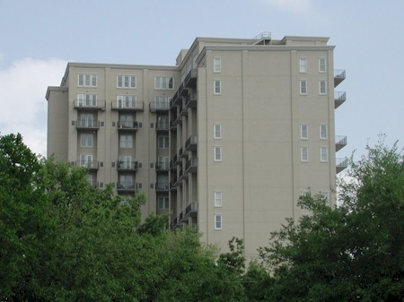 West side of building looks across Katy Trail to Highland Park homes